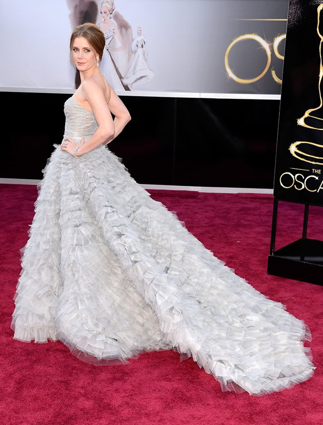 She's not only walking the red carpet, she's swiffering at the same time.