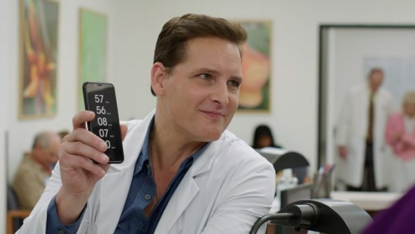Peter Facinelli holding a phone in Countdown
