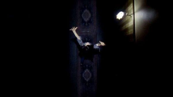 An overhead shot of Linda (Jacki Kerin) running down a hallway