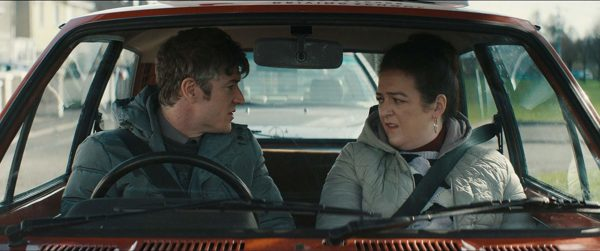 Barry Ward and Maeve Higgins sit in a car