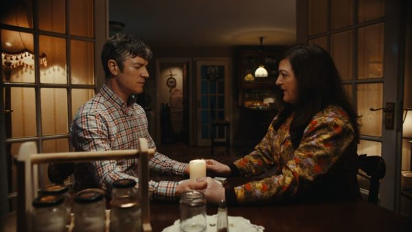 Barry Ward and Maeve Higgins hold hands for a ritual over a candle