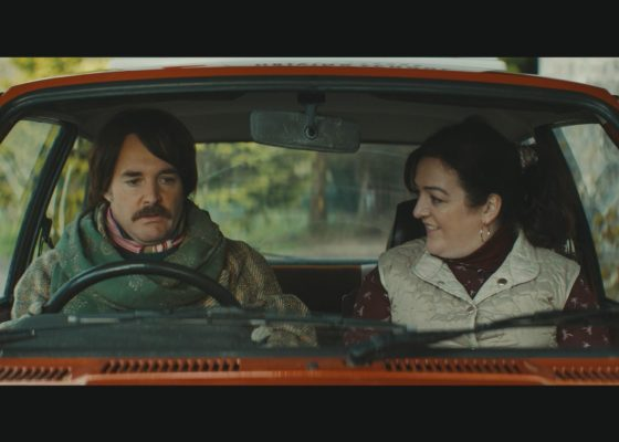 Will Forte and Maeve Higgins sit in a car