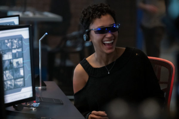 Nora (Andy Allo) laughs while wearing VR goggles