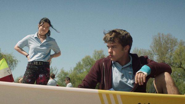 Mallory (Piper Curda) checks on Ben (John-Paul Howard) as he sits in a boat