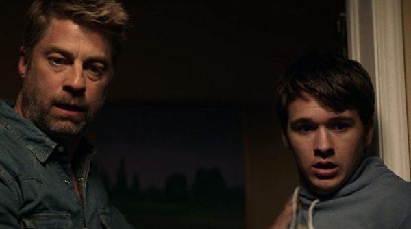 Liam (Jamison Jones) and Ben (John-Paul Howard) stare in shock at something
