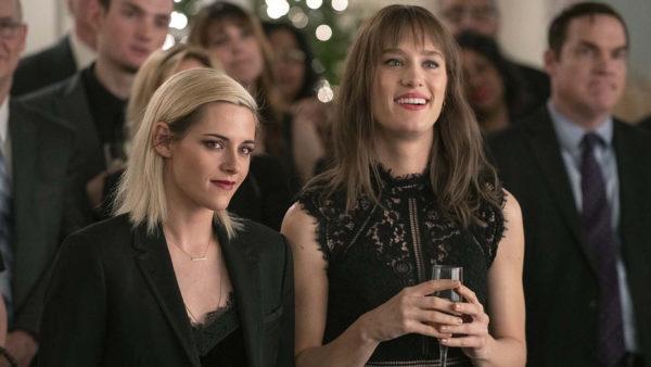 Kristen Stewart as Abby and Mackenzie Davis as Harper dressed in black formal wear