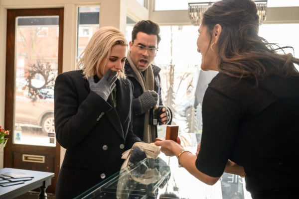 Kristen Stewart as Abby and Dan Levy as John gasp over an engagement ring