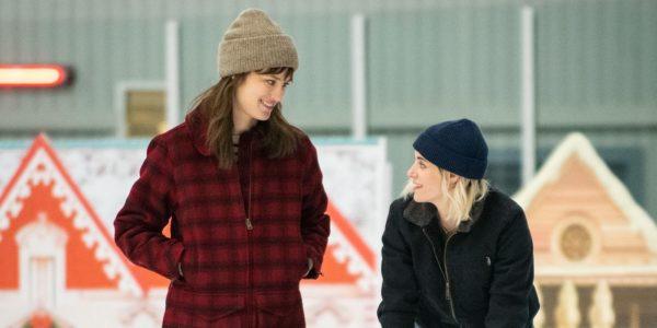 Mackenzie Davis as Harper looks down at Kristen Stewart as Abby, bent over trying to skate