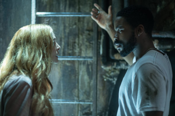 Heather Graham as Rita Blakemoor and Jovan Adepo as Larry Underwood in the sewers