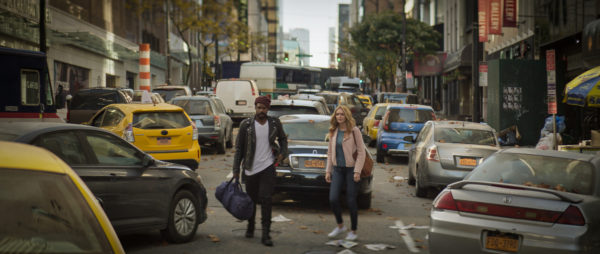 Jovan Adepo as Larry Underwood and Heather Graham as Rita Blakemoor stand in a deserted NY street filled with abandoned cars