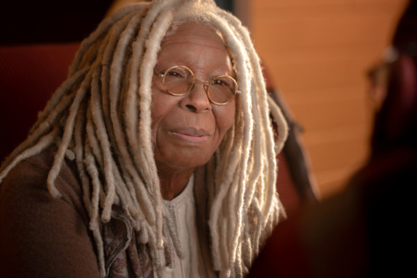 A elderly woman with white dreads