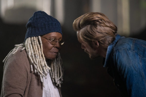 A blonde haired man threatens an older Black woman in glasses and a beanie