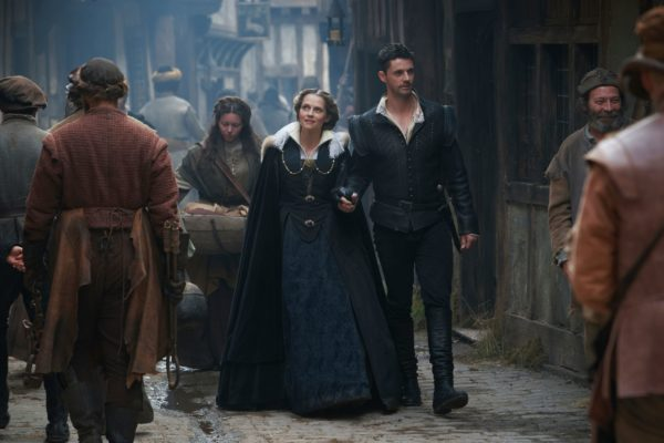 Diana and Matthew walk down the London streets in 1590 clothing
