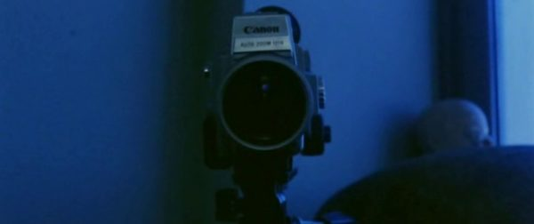 A video camera bathed in blue light